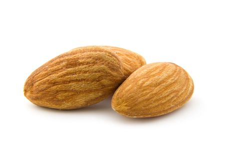 Three almonds isolated on white background photo