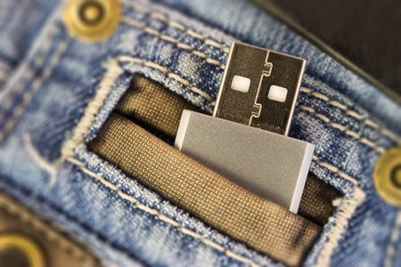 Usb flash disk in jeans pocked photo