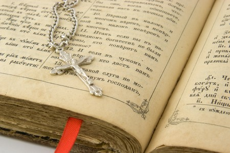 crist: Old bible and silver cross