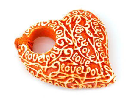 Ceramics heart isolated on white background. photo