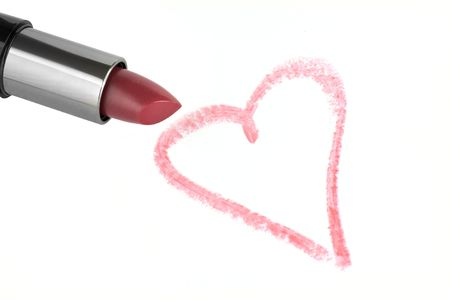 Lipstick and heart on paper photo