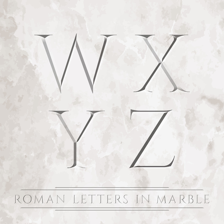 Ancient Roman letters chiseled in marble.