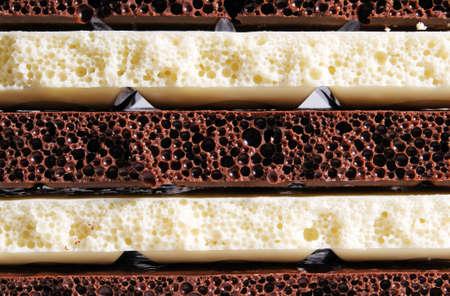 porous: Strips of black and white porous chocolate