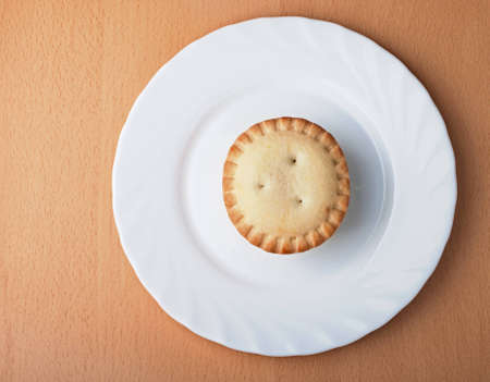 Baking on a white plate on a table, the top view Stock Photo - 13205439