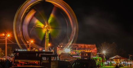 Fun Fair In Downtown Night Scene