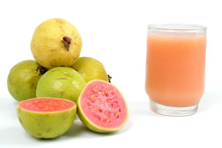 guava: Juice of Guava Fruit over white background Stock Photo