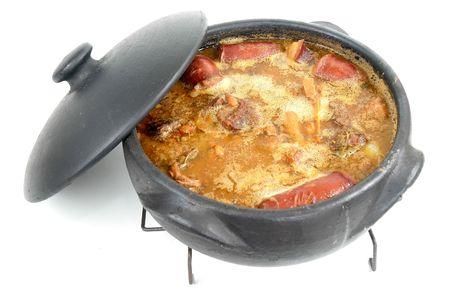 Brazilian typical food Feijoada in a mud pot. Stock Photo