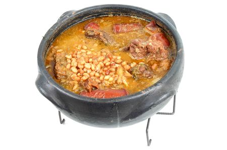 typical: Brazilian typical food Feijoada in a mud pot. Stock Photo