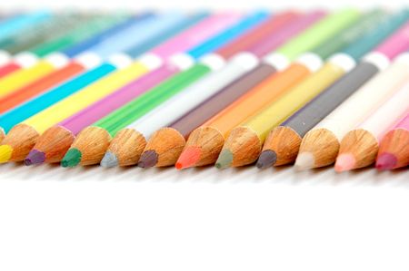 Color Pencil crayons in a line on a white table photo