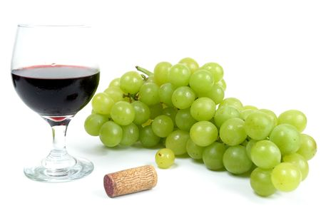 Wine in a glass and grapes over white background. photo