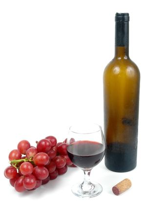 Wine bottle with a glass and grapes over white background. photo