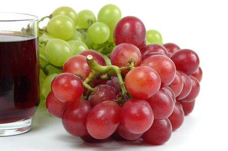 and grape juice: Grape Juice and grapes over white background.