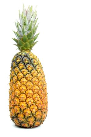 Whole pineapple over a white background.  photo