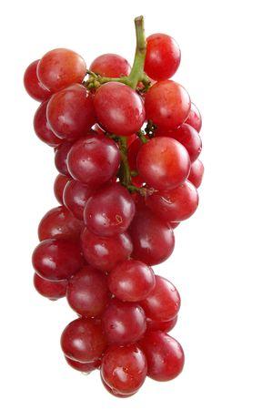 Schöne Haufen lila Trauben über weißen Hintergrund.  Standard-Bild