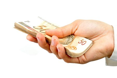 Woman hand with lots of brazilian money notes