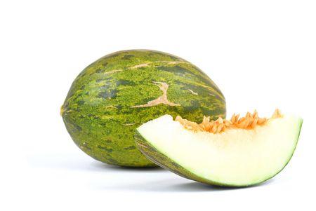 Opened Melon fruit isolated on white .