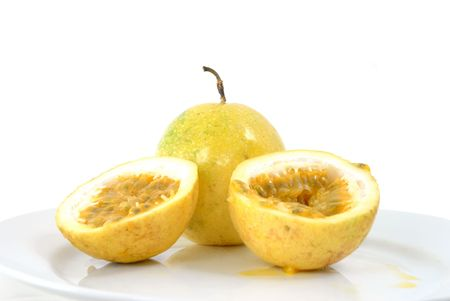 grenadilla: Passion-Fruit on a white plate .