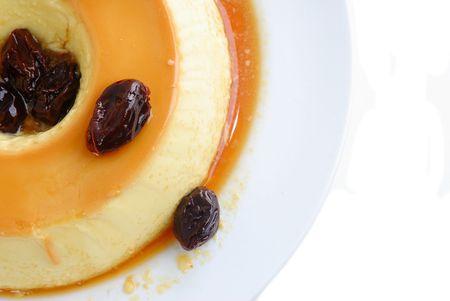 plum pudding: Budino di latte con prugna e sciroppo di caramello.