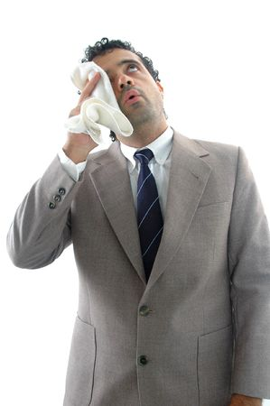 perspiration: Exhausted businessman, drying the perspiration with a towel