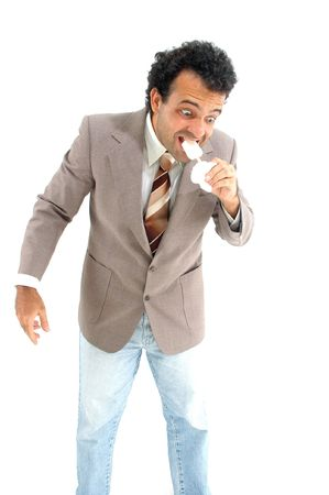 devouring: businessman devouring a popsicle . Stock Photo