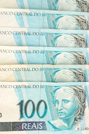 Hundreds of Brazilian real currency background . photo
