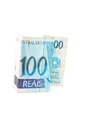Hundred currency of Brazil on white. photo