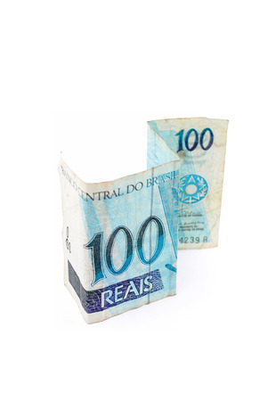 Currency of Brazilian real on white background. photo