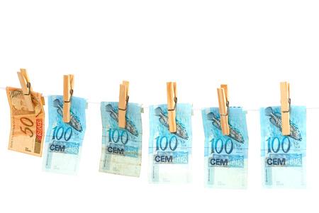 Drying money after washing. Brazilian Real. photo