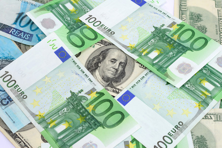 Background currencies, brazilian real, dollar and euro. photo
