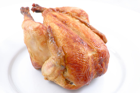 roasted chicken: Tasty Full Roast Chicken on white plate .