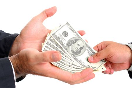 Hands receiving US Dollars from other hand - Payday