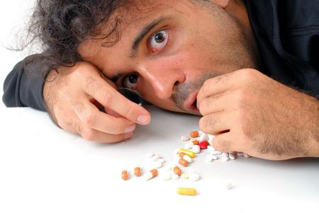 stay alert: Man eating capsule of drugs for stay alert . Stock Photo