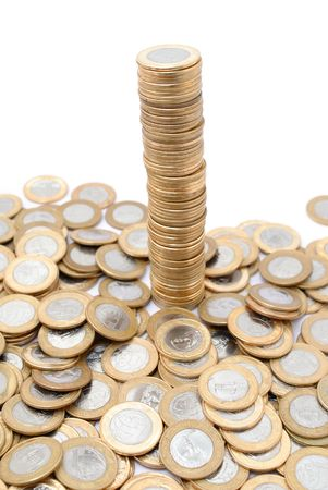 pillage: Pile of coins growing on white background . Stock Photo