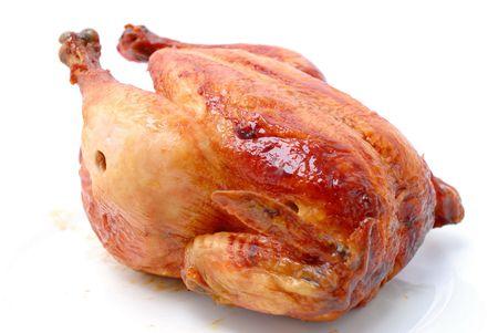 Tasty Crispy Roast Chicken on white . Stock Photo