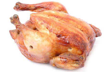 Tasty Crispy Roast Chicken on white background .