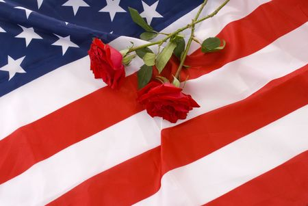Two crossed red roses in the flag of United States. Stock Photo