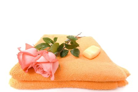 rejuvenating: Towel, Roses and Soap on white background . Stock Photo