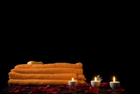 candles and flowers before towel at night . Stock Photo - 3723922