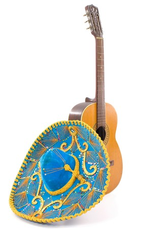 Wood Guitar and Mexican Hat on white . Stock Photo