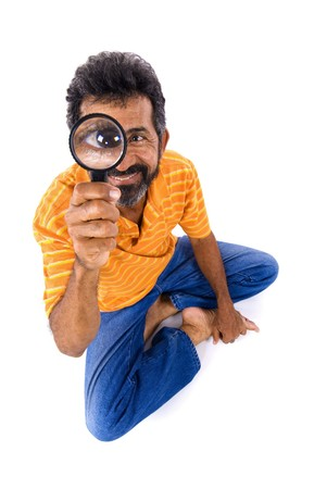 inspector kid: Close Up - Man holding a magnifying glass  .