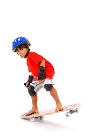 skateboarding: Boy playing with his skate on white . Stock Photo