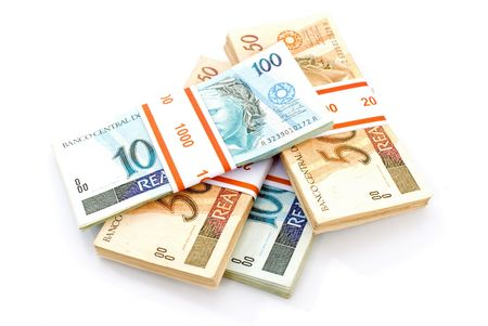 Brazilian Real currency on white . Stock Photo