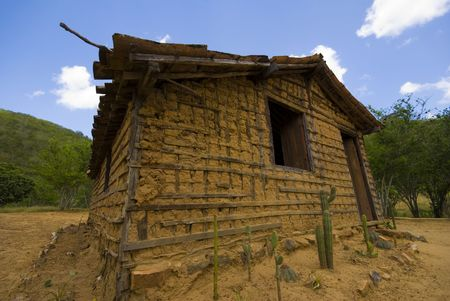 mud house: Poor mud house in the arid weather . Stock Photo