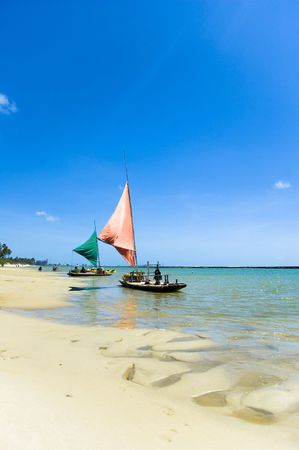 porto: Jangada - fishing boat in Porto de Galinhas, Pernambuco - Brazil Stock Photo