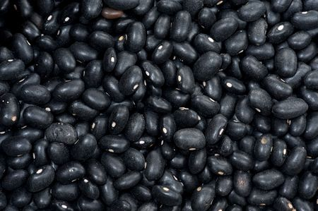 unwashed: Background of unwashed raw dark beans .
