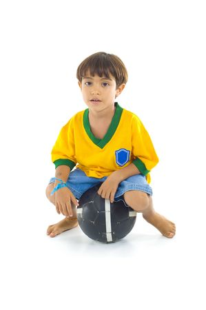 Young Child with Yellow T-shirt sitting in the ball . photo
