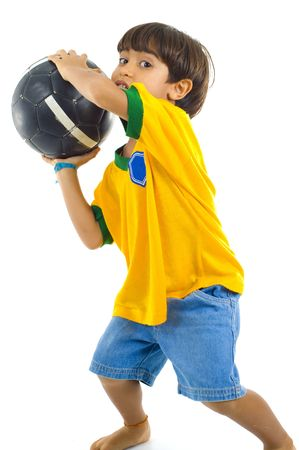 Young Child as goalkeeper, with Yellow T-shirt and a ball . photo