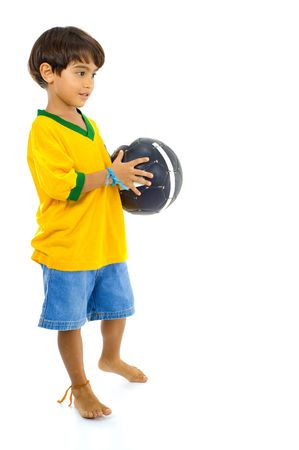 Young Child with Yellow Brazil T-shirt and a ball . photo