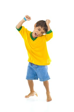 Young Brazilian supporter celebrating a score .  photo