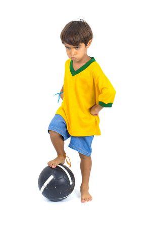 Angry young Brazilian Player and a ball . photo